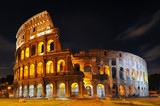 Twilight view of Colosseo in Rome, elliptical largest amphitheatre of Roman Empire ancient civilization, Rome, Italy.
