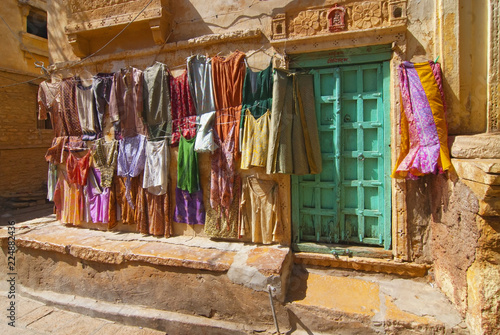Foto Murales Colourful clothes on a line in the streets of Jaisalmer in India.