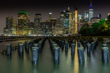 Long time exposure of New York City Manhattan downtown skyline at night viewed from Brooklyn Bridge park - 224890451