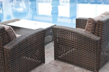 wicker sofa sets by the pool closeup view - 224891055