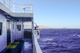 2018 September 18th, Syros ferryboat, Greece. Wind can be extremely strong on the Aegean sea. When is more than 70Km/h also big ferriboats cannot travel. - 224895218