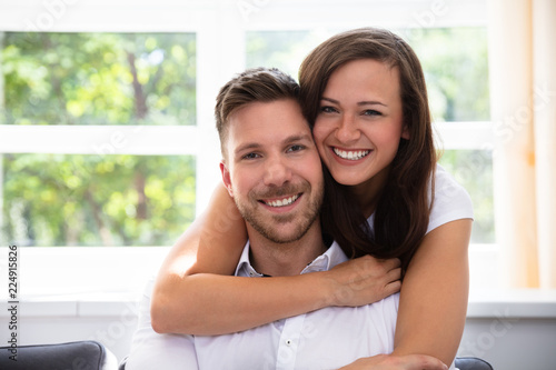 Leinwandbild Motiv Portrait Of A Happy Couple