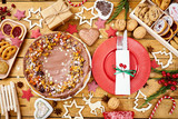 old wooden table with delicious Christmas cake decorations and different cookies