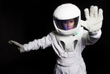 Astronaut from the future says stop. Portrait of a young woman in a helmet - 224933624