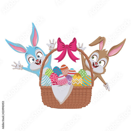 Rabbit with easter eggs in basket