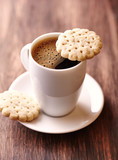 Cup of coffee and butter biscuits. Rustic wooden background. Close up. - 224992858