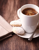 Cup of coffee and butter biscuits. Rustic wooden background. Close up. - 224997465