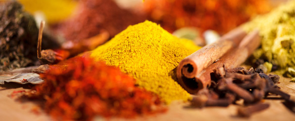 Spice. Various indian spices and herbs colorful background. Assortment of seasonings, condiments © Subbotina Anna