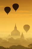 Silhouette of the Tourist Balloon fly over pagoda in the morning on Bagan, Myanmar. Balloon flying is very popular for tourists for pagoda sightseeing - 224999696
