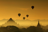 Silhouette of the Tourist Balloon fly over pagoda in the morning on Bagan, Myanmar. Balloon flying is very popular for tourists for pagoda sightseeing - 224999804