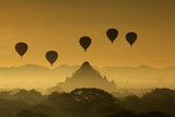 Silhouette of the Tourist Balloon fly over pagoda in the morning on Bagan, Myanmar. Balloon flying is very popular for tourists for pagoda sightseeing
