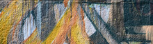 """Постер, картина, фотообои """"Fragment of graffiti drawings. The old wall decorated with paint stains in the style of street art culture. Colored background texture in warm tones"""""""