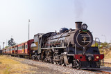 old steam locomotive in station