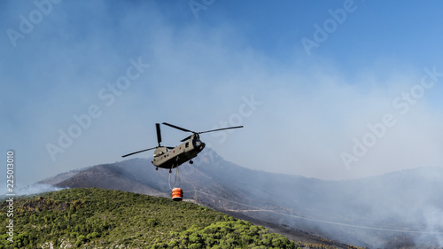 Fototapeta Fire Fighting Helicopters in Action