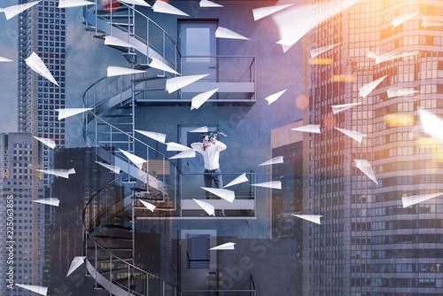 Leinwandbild Motiv Man with crossbow shooting paper planes, business