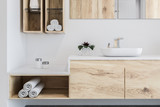 Wooden bathroom, white sink close up