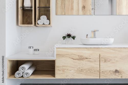 Leinwandbild Motiv Wooden bathroom, white sink close up