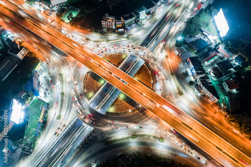 Background scenic road, The light on the road roundabout at night and the city in Bangkok, Thailand. Aerial view. Top view.  - 225066096