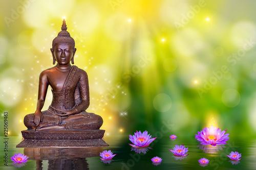 Leinwandbild Motiv Buddha statue water lotus Buddha standing on lotus flower on orange background
