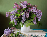 Bouquet of purple lilac in a vase on the table. - 225082008
