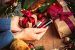 hands holding a lipsticks and Christmas gift