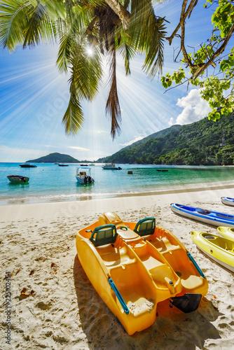 beautiful sunstar and boats at port launey, seychelles 7 - 225102454