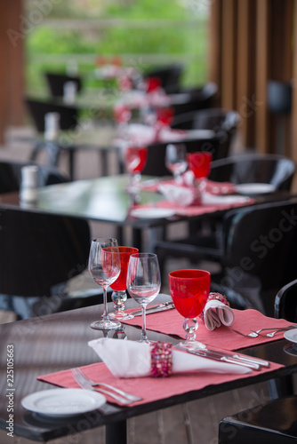 table setting at restaurant - 225105663