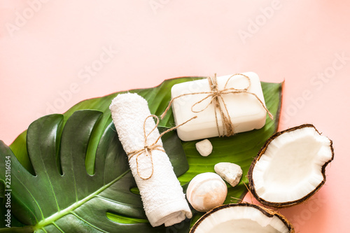 Beautiful Spa composition with coconut on pink background © puhimec