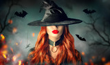 Halloween. Sexy witch portrait. Beautiful young woman in witches hat with long curly red hair - 225139402