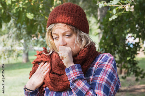 Leinwanddruck Bild Girl during cold day wearing warm clothes outdoor