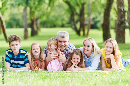 Family with many children outdoors - 225145886