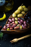 Assorted of marinated olives with herbs and rosemary - 225152094