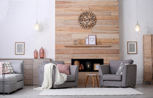 Leinwandbild Motiv Cozy furnished apartment with niche in wooden wall and armchair. Interior design