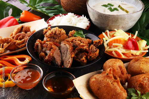 Chines food with fried duck with curry sauce. tom kah kai soup, dumplings and rice. Fried banana and vegetables. Street food with wan tan. - 225210881