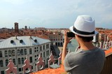 young photographer with smart phone takes pictures of old palace