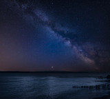 Vibrant Milky Way composite image over landscape of Beautiful sea looking across Solent to Isle of Wight in England - 225220441