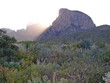 Sunlight behind Chisos Mountain peak