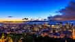 Beautiful Montreal at sunrise or sunset. Amazing view from Belvedere with colorful autumn leaves. Stunning panorama of Montreal downtown skyline in the fall night time.