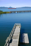 Vertical of Barge on the Columbia River with dock  - 225249076