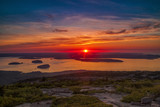 Sun breaking the horizon oveer the Atlantic Ocean viewed from Cadillac Mountain in Acadia National Park