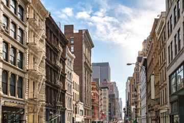 Sunlight shines on the buildings along Broadway in SoHo, New York City
