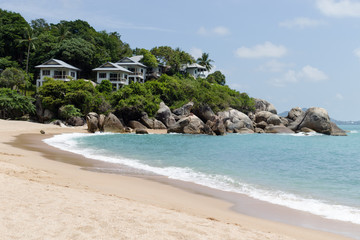 Beautiful tropical view of blue sky, sandy beach, and blue tropical sea in Koh Samui, Thailand