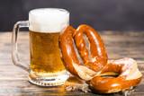 Oktoberfest concept - beer mug with german pretzel