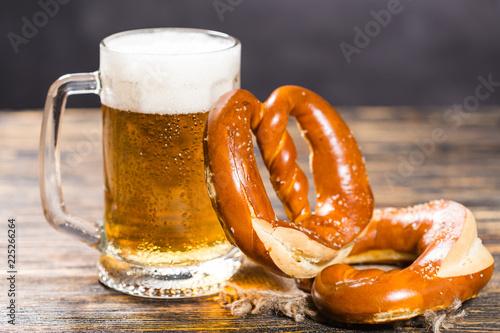Leinwanddruck Bild Oktoberfest concept - beer mug with german pretzel