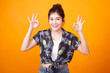 Asian woman show double OK hand sign  and smile in tropical shirt