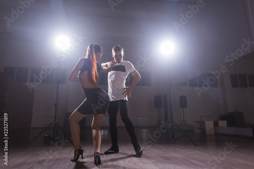 Young couple dancing latin dance Bachata, merengue, salsa. Two elegance pose in dance class - 225271819