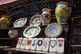 Ceramic vases and tiles featuring some of the districts represented in the famous palio horse race