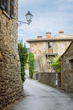 Sreet in a small village of medieval origin. Volpaia, Tuscany, Italy.