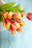 Bunch of Tulips on a Tray. Flower background. Wooden background. Copy space. - 225283230