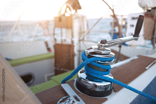 Leinwanddruck Bild Winch with rope on a sail boat in the sea